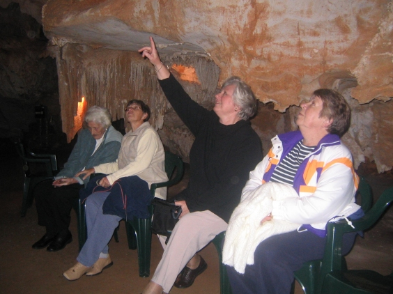 Visitors relaxed on seats in the cave
